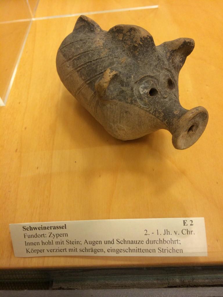 "Teach yourself German!  ""Schweinerassel,"" a ceramic bottle in the shape of a pig.  2nd century!"
