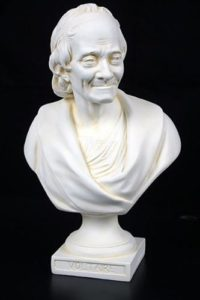 Bust of voltaire, smiling.